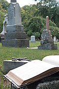 Open Bible and cross in graveyard (portrait version)