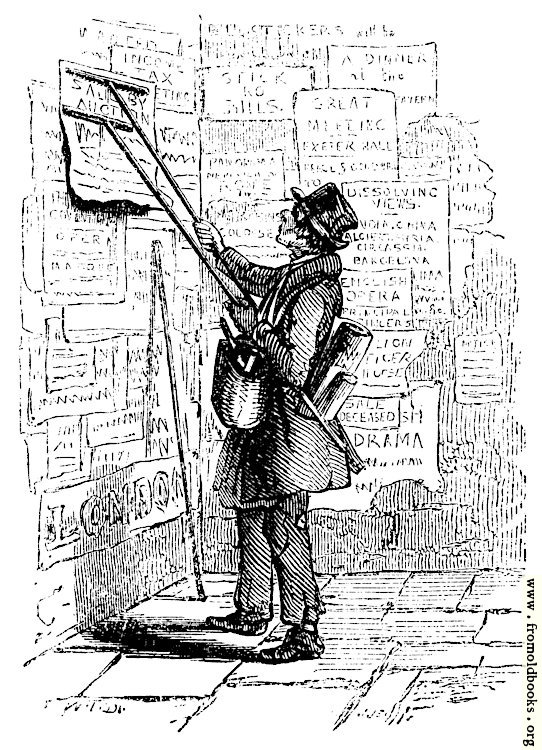 [Picture: Man putting up a poster]