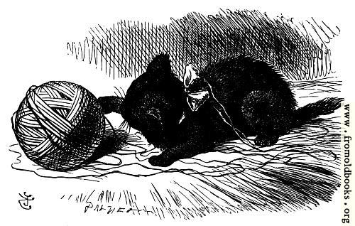 [Picture: The black kitten with a ball of twine]