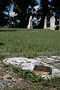 [Picture: Old book on gravestone]