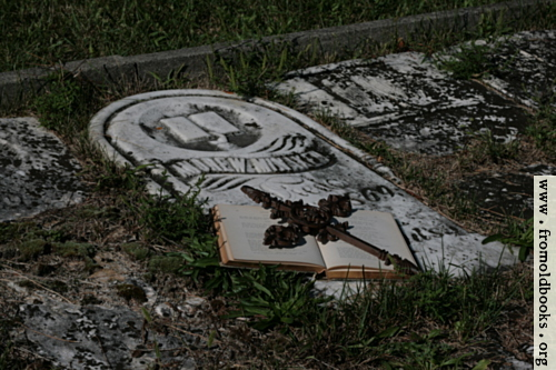 [Picture: Open book with iron cross on grave]