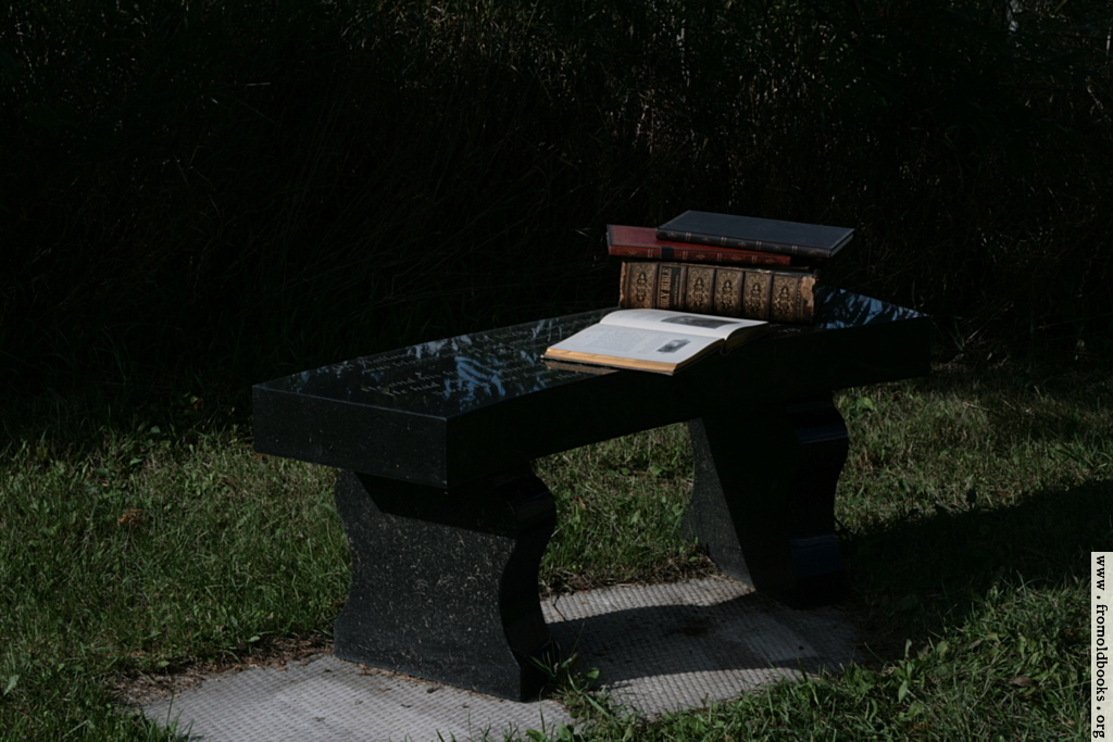 [Picture: Stone bench with books 1]