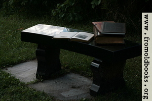 [Picture: Stone bench with books 2]
