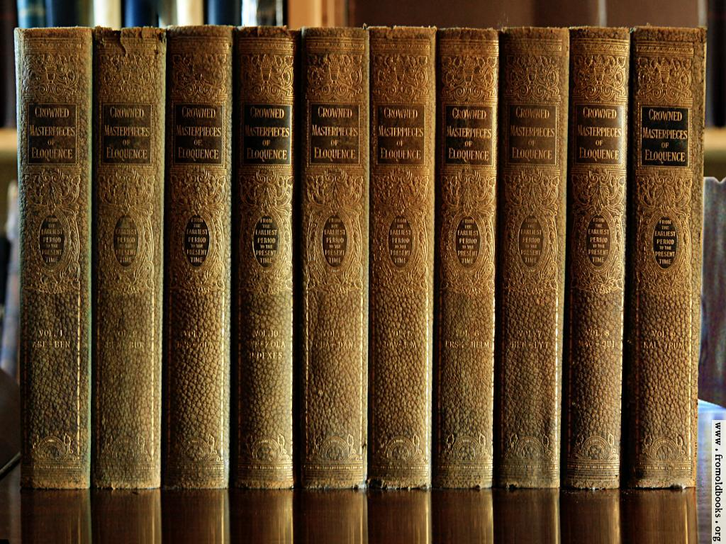 [Picture: Green and Gold books on polished wood]