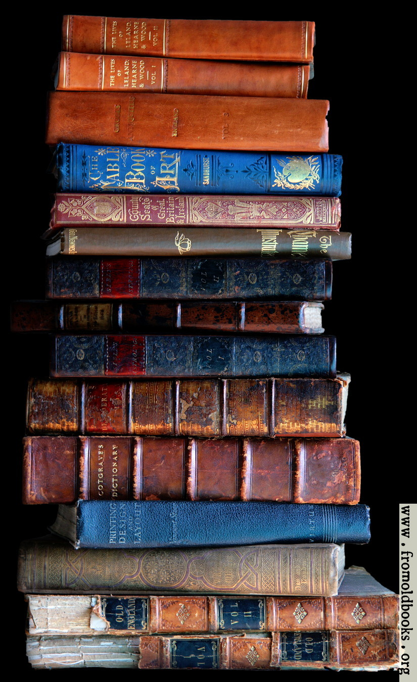 Stack of old books, dark background